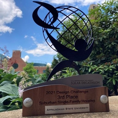 3rd place trophy for the Suburban Single Family Division of the 2021 Solar Decathlon Design Challenge