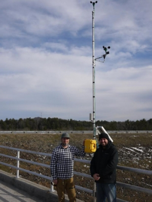 Brent Summerville and Robb O'Brien install a wind measurement system