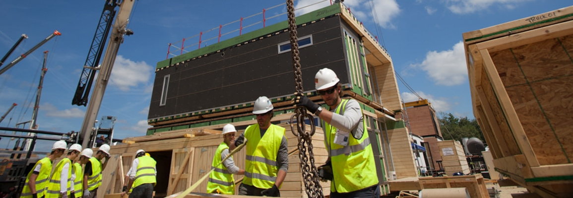 students constructing sustainable housing for competition