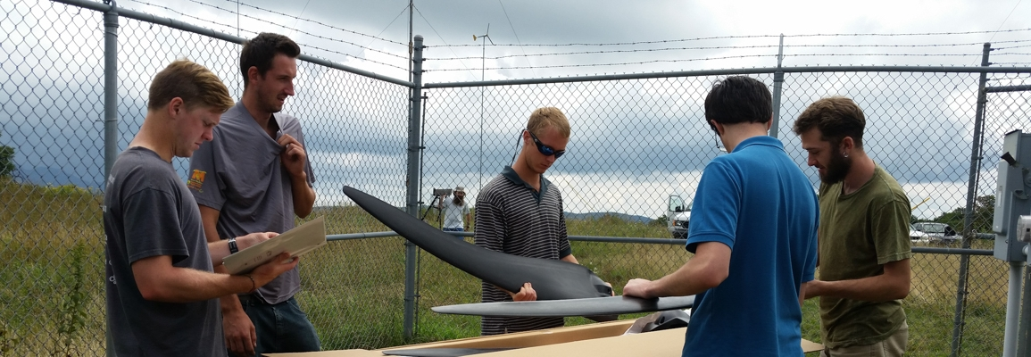 students unpacking parts for a wind turbine