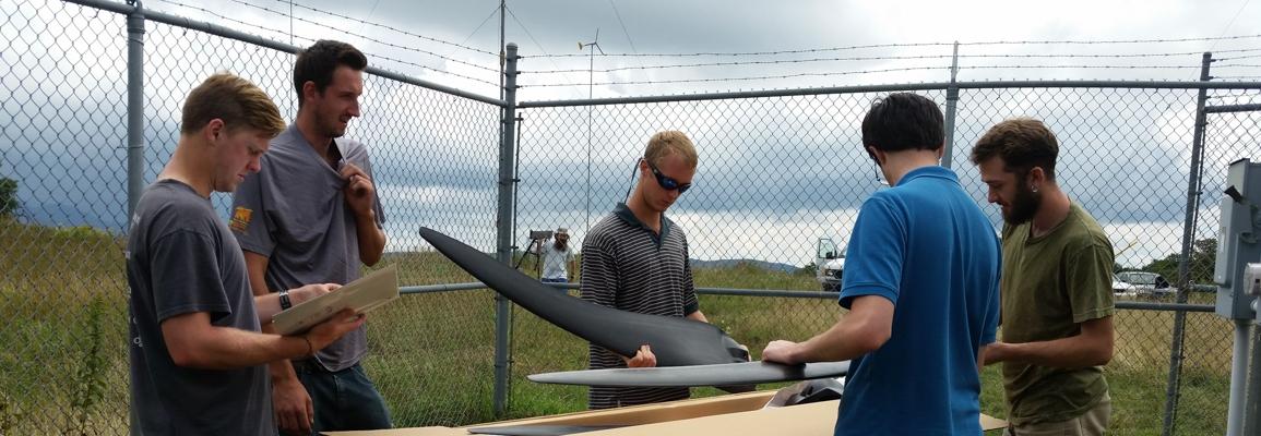 grad students assembling a small wind turbine