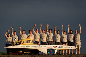 solar vehicle team group photo with race car